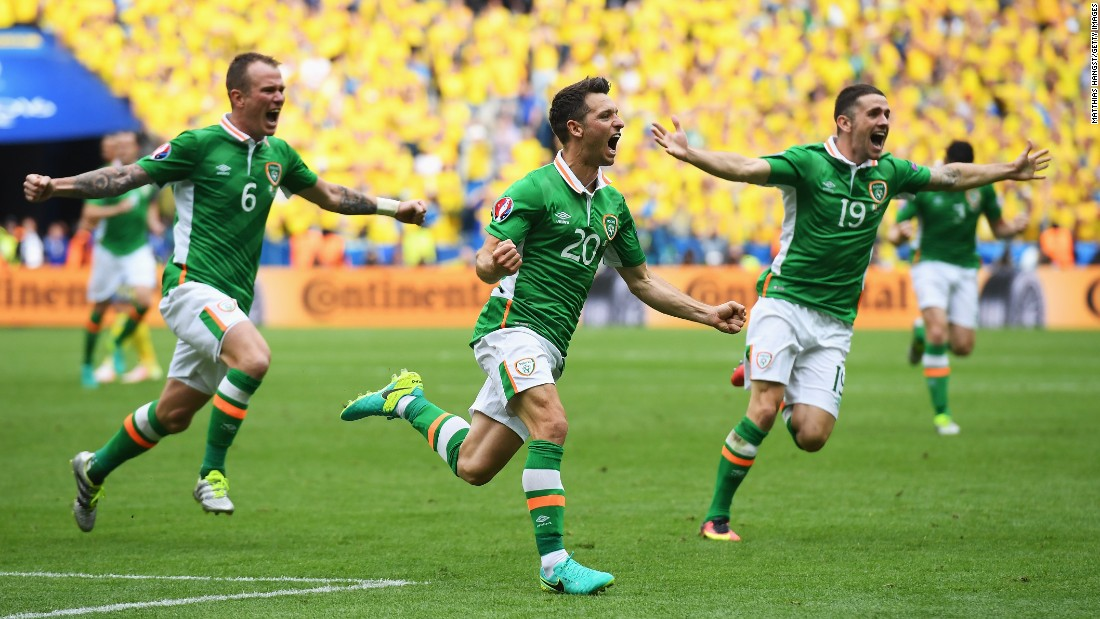 Hoolahan, center, celebrates his goal.