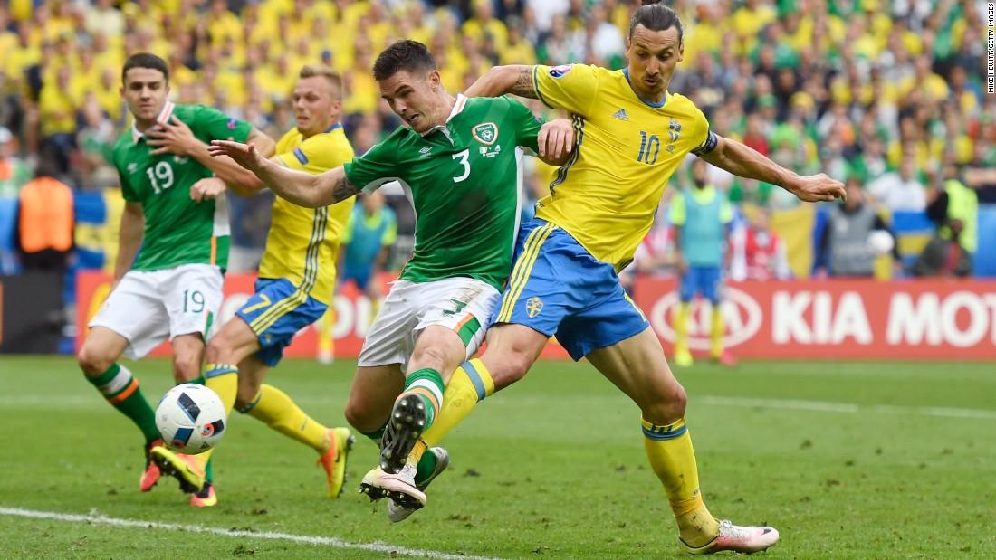Clark fights off Swedish striker Zlatan Ibrahimovic during the match.