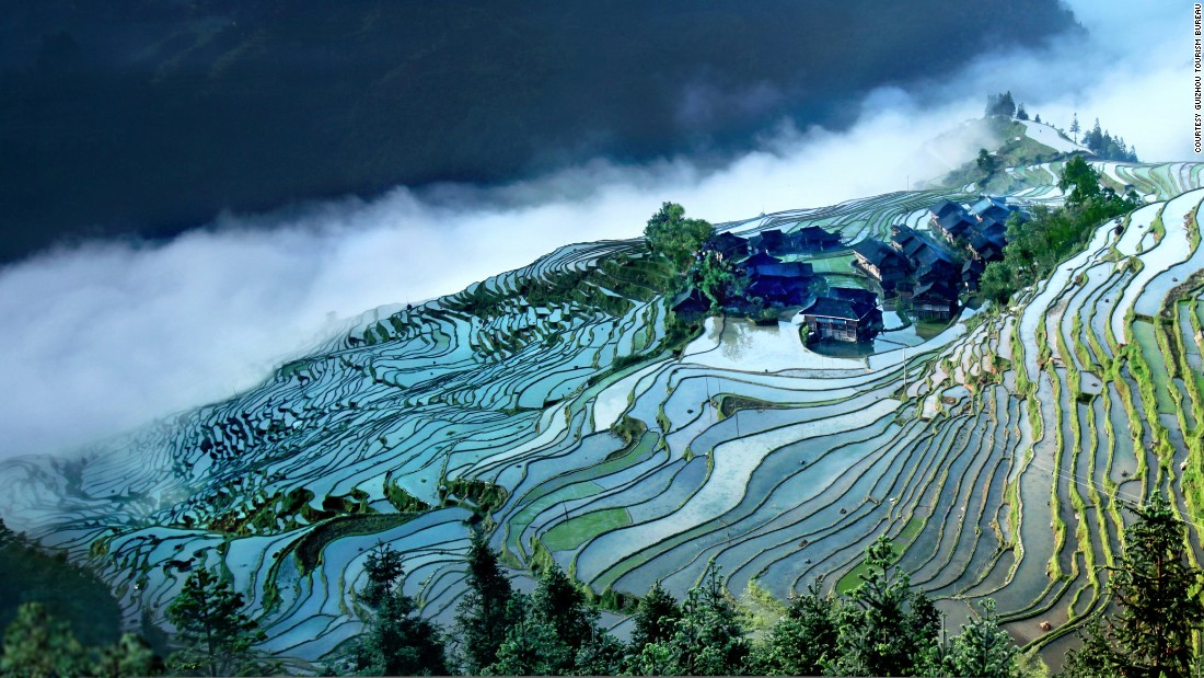 Terraced farming is common in hilly Guizhou.  The Jiabang rice terraces, near Congjiang in the province's southeast corner, look their best during summer rains, which leave the fields shimmering in misted reflections.