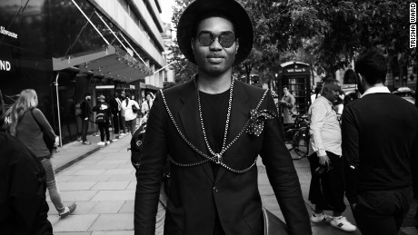 Style blogger Omiri Thomas wears Hugo Boss and Topman outside the central London venue.