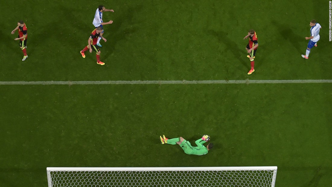 Belgian goalkeeper Thibaut Courtois makes a save.