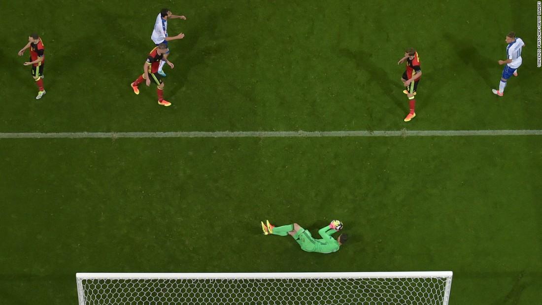Belgian goalkeeper Thibaut Courtois makes a save.