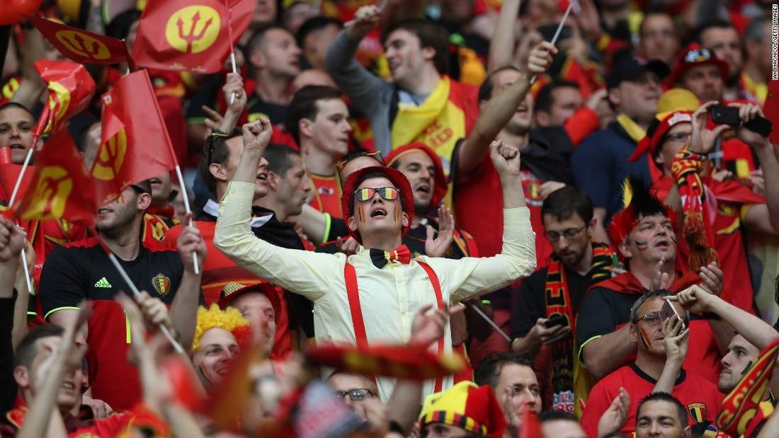 Belgian fans soak up the atmosphere at the stadium in Lyon, France.