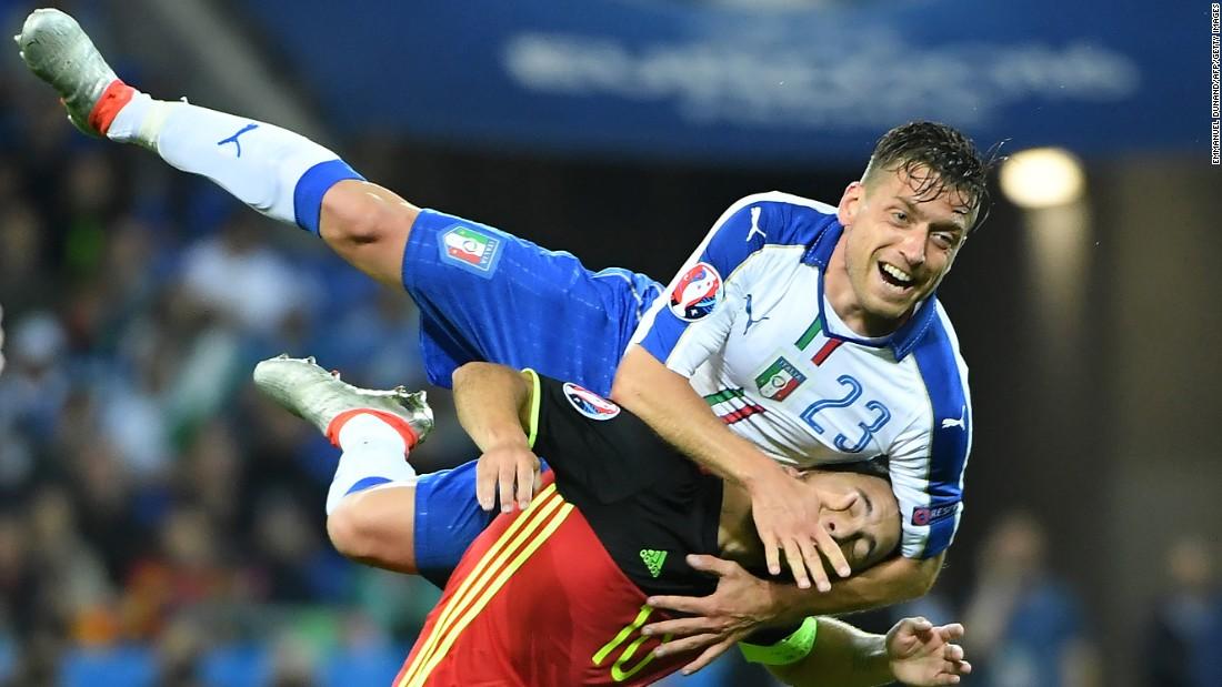 Giaccherini climbs over Belgium captain Eden Hazard.