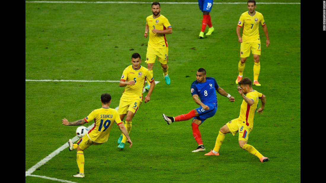 "Dimitri Payet unleashes a powerful shot that gave France a 2-1 victory over Romania in <a href=""http://www.cnn.com/2016/06/10/football/gallery/euro-football-0610/index.html"" target=""_blank"">the opening match</a> of Euro 2016. The match was played in the Stade de France just north of Paris on Friday, June 10. <a href=""http://www.cnn.com/specials/sport/football/euro2016"" target=""_blank"">Full coverage of Euro 2016</a>"