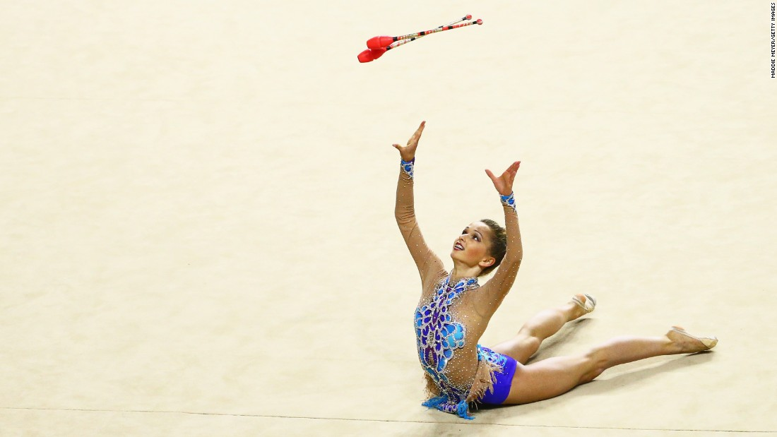 Rhythmic gymnast Nicole Sladkov performs with clubs Sunday, June 12, at the USA Gymnastics Championships.