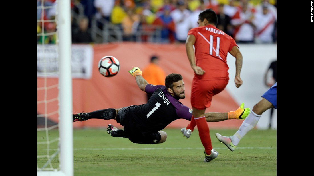 "Peru's Raul Ruidiaz scores a goal past Brazilian goalkeeper Alisson during a Copa America match on Sunday, June 12. It <a href=""http://bleacherreport.com/articles/2645931-brazil-vs-peru-score-reaction-from-2016-copa-america"" target=""_blank"">appeared to be a handball,</a> but the call wasn't made and Peru won the match 1-0. With the victory, Peru advanced to the tournament quarterfinals and Brazil was eliminated."