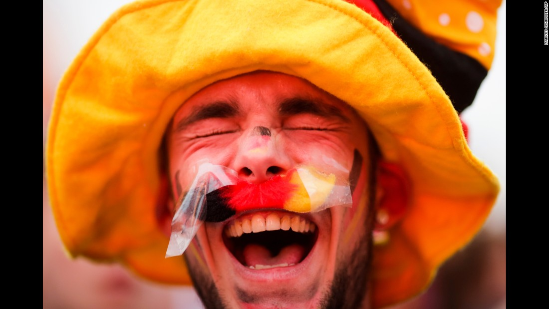 "A Germany fan enjoys the atmosphere in Berlin before watching a Euro 2016 match on Sunday, June 12. <a href=""http://www.cnn.com/2016/06/12/football/euro-2016-germany-ukraine/index.html"" target=""_blank"">Germany defeated Ukraine</a> 2-0 in Lille, France."