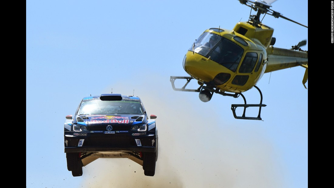 The rally car of Jari-Matti Latvala and Miikka Anttila catches air during a race in Italy on Saturday, June 11.