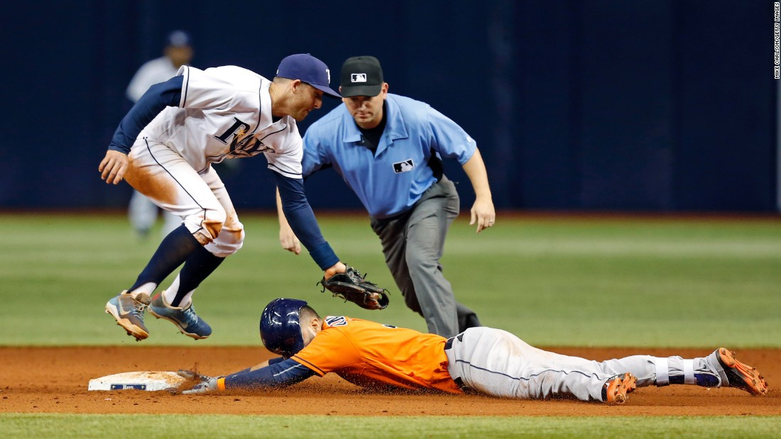Houston's Marwin Gonzalez slides under the tag of Tampa Bay's Brad Miller after hitting a double on Friday, June 10.