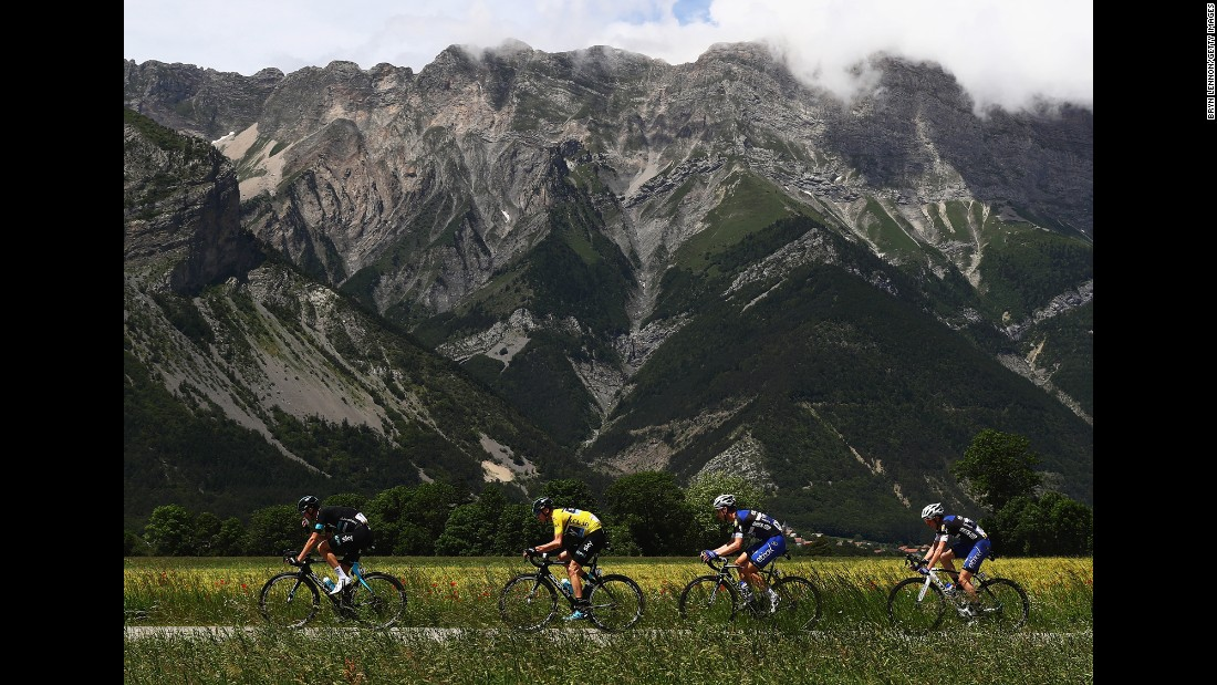 Chris Froome, in the yellow jersey, rides with teammates in Superdevoluy, France, during the last stage of the Criterium du Dauphone on Sunday, June 12. Froome won the road race for the third time in his career.