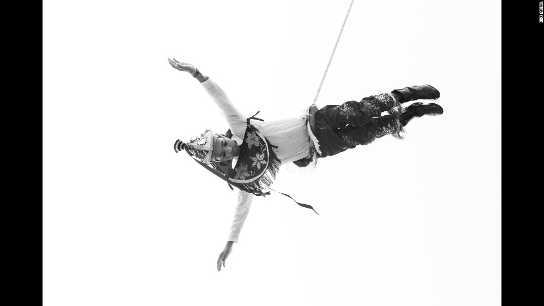 Roberto Jimenez Mora twists in the air during the Danza de los Voladores, or the Dance of the Flyers, in Mexico. The high-flying tradition goes back centuries.