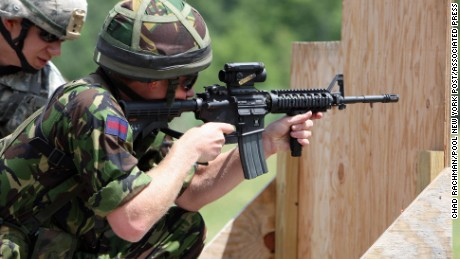 FILE - In this June 25, 2010, file photo Britain's Prince Harry fires a Colt M4 assault riffle on a United States Military Academy range in West Point, N.Y.  The Defense Department is searching for the successor to the M4 combat rifle and gun makers are loading with lobbyists to win the work. Colt Defense of West Hartford, Conn., had an exclusive deal to provide M4s to the U.S. military and didnt need a hired gun looking out for its interests in Washington. (AP Photo/Chad Rachman, Pool, File)
