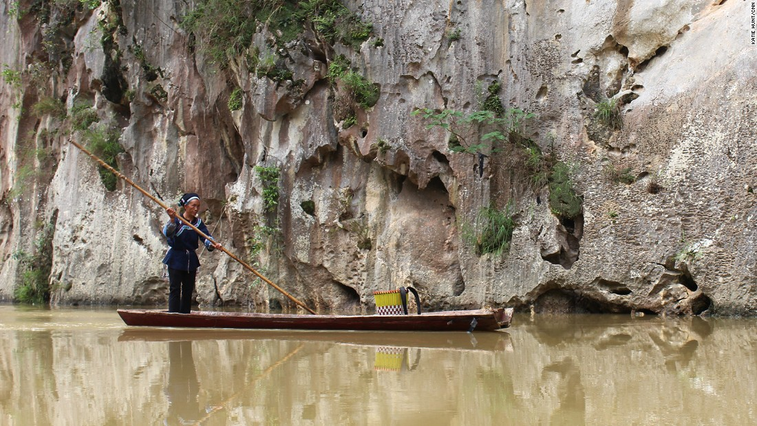 "Bamboo rafts are the traditional mode of transport on Guizhou's many rivers. This ""sinking stream"" in the Getu river scenic area disappears into an eerie karst cave network."