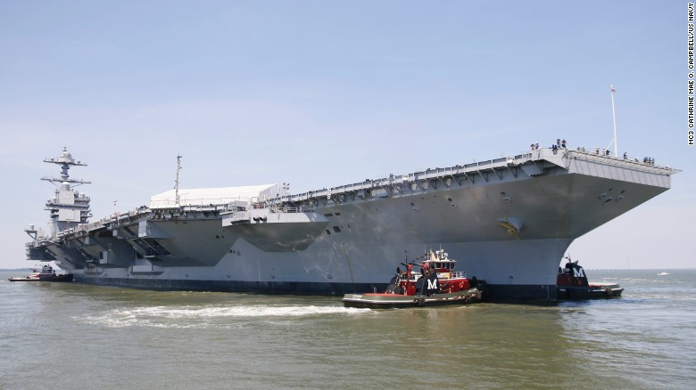 Tug boats maneuver the aircraft carrier Pre-Commissioning Unit Gerald R. Ford (CVN 78) into the James River during the ship's turn ship evolution on June 11, 2016. This is a major milestone that brings the country's newest aircraft carrier another step closer to delivery and commissioning later this year.