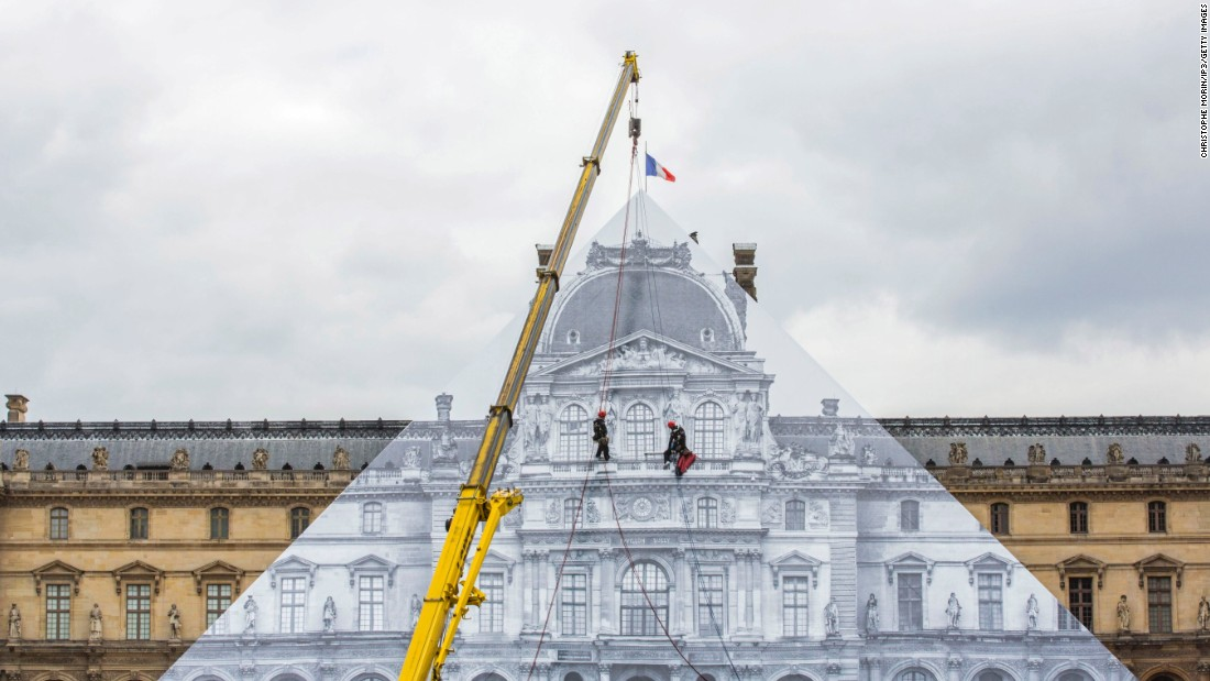 "The latest installation from French street artist JR <a href=""http://www.cnn.com/2016/05/24/arts/jr-louvre/"" target=""_blank"">sees the Louvre ""disappear""</a> under a trompe l'oeil photographic collage."