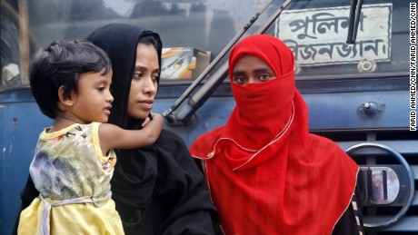 Sanjida Begum (in black veil) waits in front of Dhaka Magistracy to find out where her husband is, after he was detained by city police in Dhaka on Tuesday.