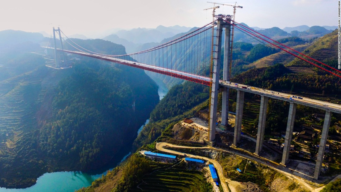 This huge suspension bridge, which crosses the Qingshui River in Wengan county, southwest Guizhou, is one of the world's highest bridges. Built in rocky karst terrain, the 2,171-meter-long structure opened last year and improves transport links between the provincial capital Guiyang and Yunnan to the southwest.