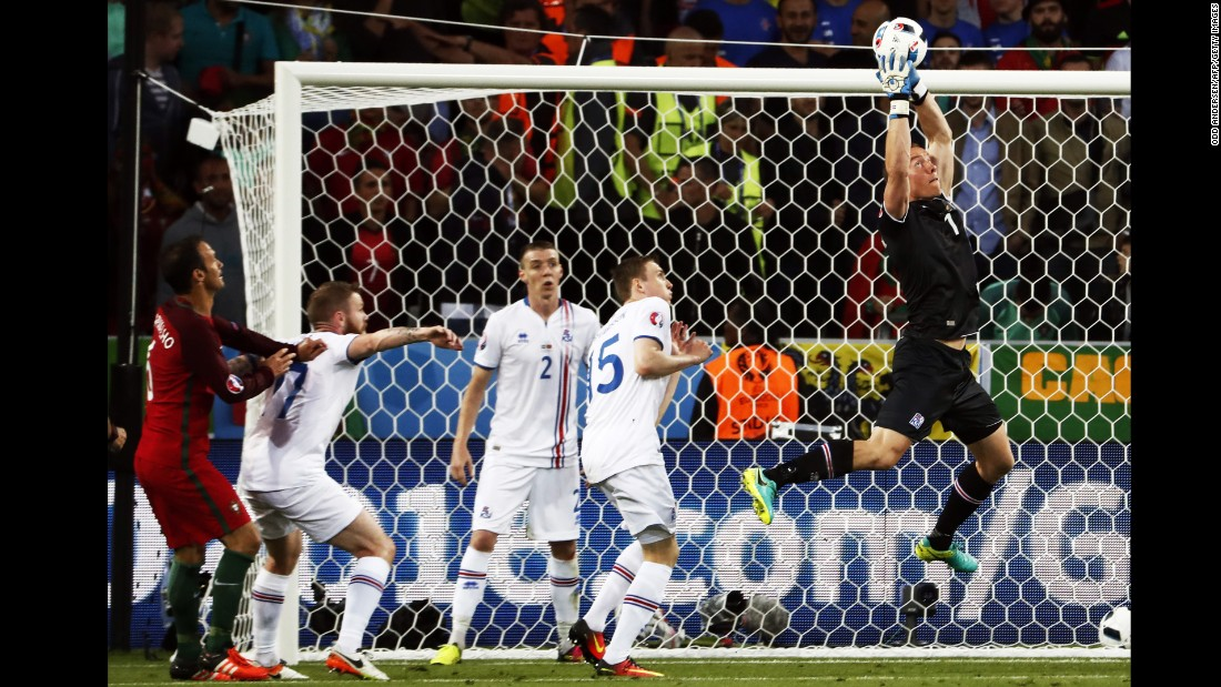 Iceland goalkeeper Hannes Thor Halldorsson makes a save during the draw with Portugal.