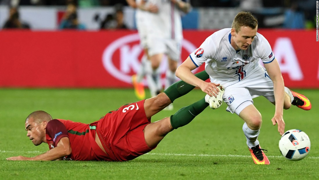 Portuguese defender Pepe collides with Jon Dadi Bodvarsson.