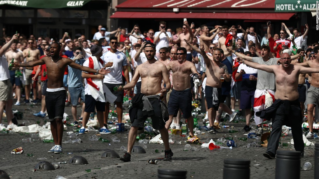 England fans, seen here, clash with Russian fans before their match in Marseille on Saturday. UEFA's executive committee has warned both England and Russia that their teams could face further sanctions -- including potential disqualification from the tournament -- if their fans are involved in more violence.