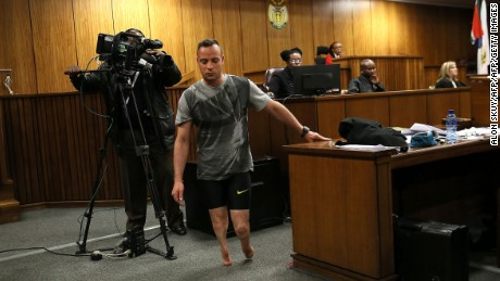 Paralympic athlete Oscar Pistorius walks in the courtroom without his prosthetic legs during his resentencing hearing for the 2013 murder of his girlfriend Reeva Steenkamp at the Pretoria High Court on June 15, 2016. A sobbing Oscar Pistorius walked hesitantly on his stumps around court on June 15 in a dramatic demonstration of his disability ahead of his sentencing for murdering his girlfriend Reeva Steenkamp. / AFP PHOTO / POOL / Alon SkuyALON SKUY/AFP/Getty Images