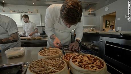 Esben Holmboe Bang at work in Maaemo's mezzanine-level kitchen.