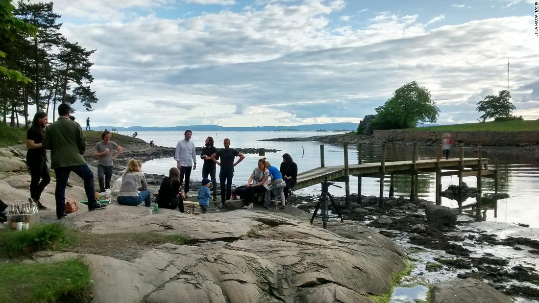 "As Norwegians love to spend the precious summer months outdoors, the week with CNN finished with a barbecue on Bygdoy Peninsula. Holmboe Bang explains, ""We're just getting some good friends together, we have some sausages, some scallops that we're going to eat raw."""