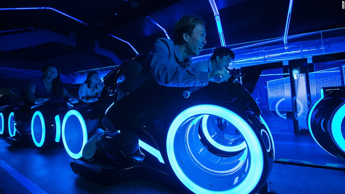 "Based on the TRON films, this coaster places riders atop individual, two-wheeled ""lightcycles"" that are launched into a game world of lights, projection and sound effects. Disney staff say it's one of the fastest roller coaster attractions at any Disney theme park worldwide."