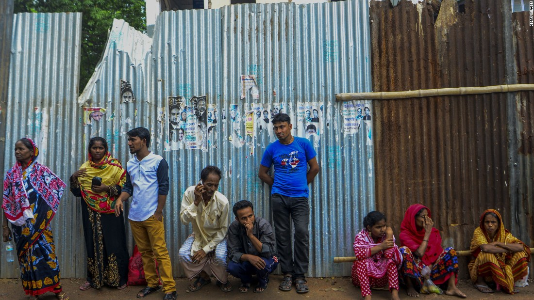 Relatives of men arrested in the nationwide crackdown wait for their release outside a Dhaka court.