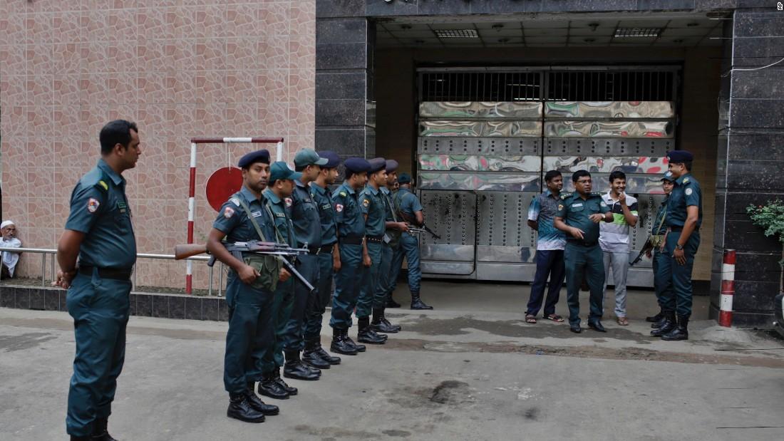 Bangladeshi policemen stand guard outside the Dhaka Central Jail.