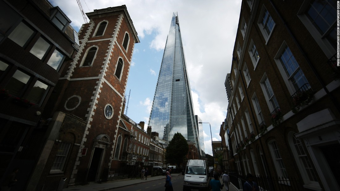 The Shard towers over St Thomas Street in London, England.