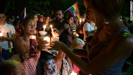 People gather during a vigil at the Hato Rey LGBT Community Center in San Juan, Puerto Rico, on Tuesday, June 14.