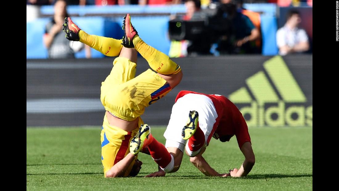 Romania's Cristian Sapunaru collides with Mehmedi.