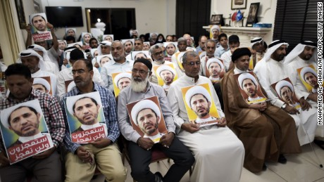 Al-Wefaq supporters hold portraits of leader Sheikh Ali Salman on May 29, in protest against his arrest.