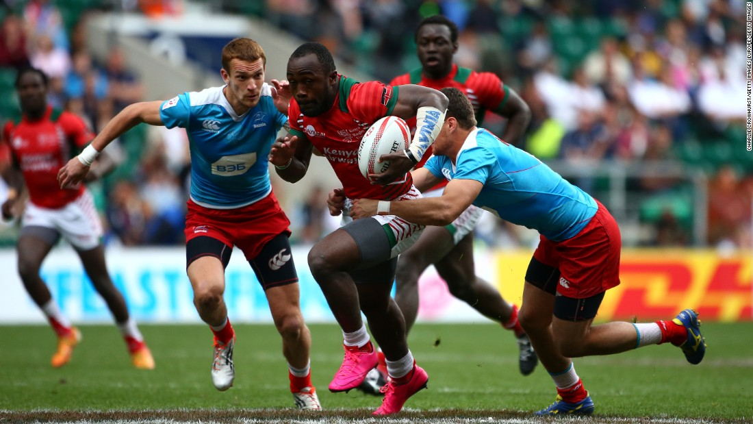 Kenya's Frank Wanyama looks to break the Russian defense line at Twickenham Stadium.