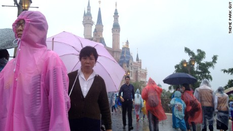 Theme Park Guy Stefan Zwanzger (behind the lady with the pink umbrella) braved the rains to get a preview of Shanghai DIsneyland.