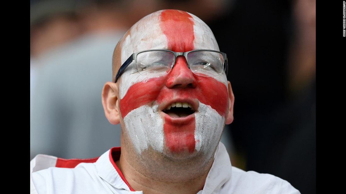 An England supporter smiles at the stadium.