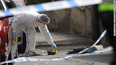 Forensic police examine the scene of the attack.