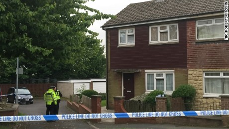 Police search a house near the scene of Jo Cox's killing in Birstall, England.