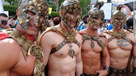 Participants dressed as Roman warriors at the annual gay parade in Taipei on October 25, 2014.