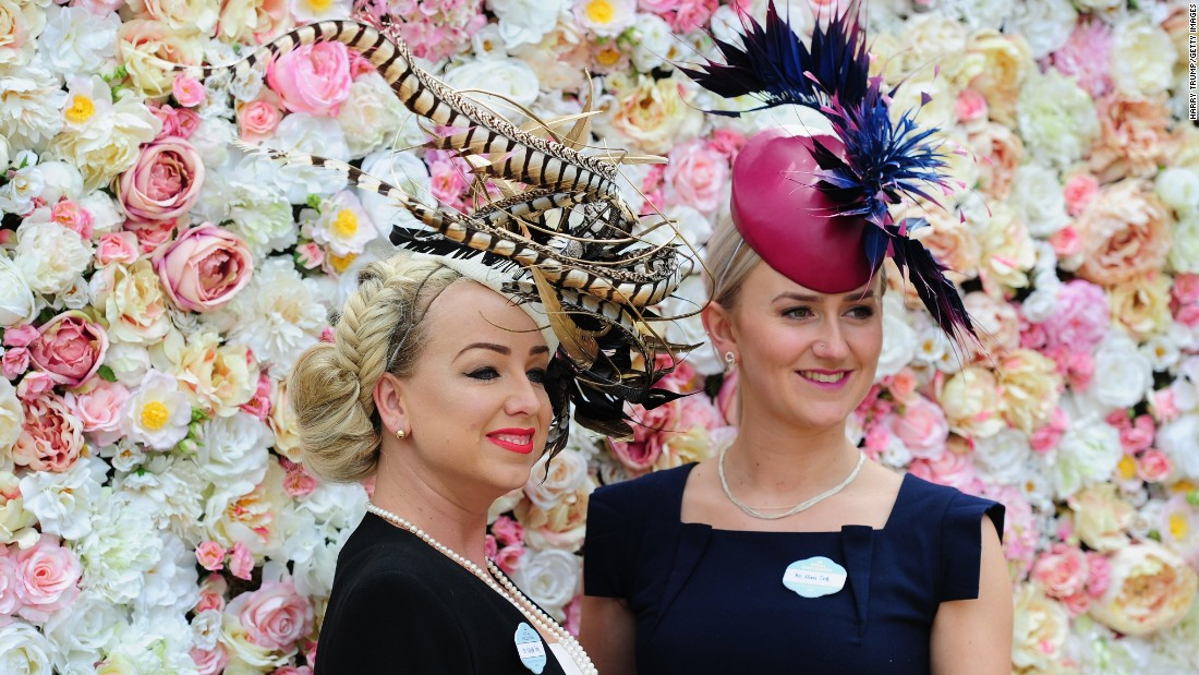 Women pose during the third day of Royal Ascot 2016 at Ascot Racecourse on Thursday June 16, in Ascot, England. The Thursday of Royal Ascot is also known as Ladies' Day, where traditional fashion takes center stage.