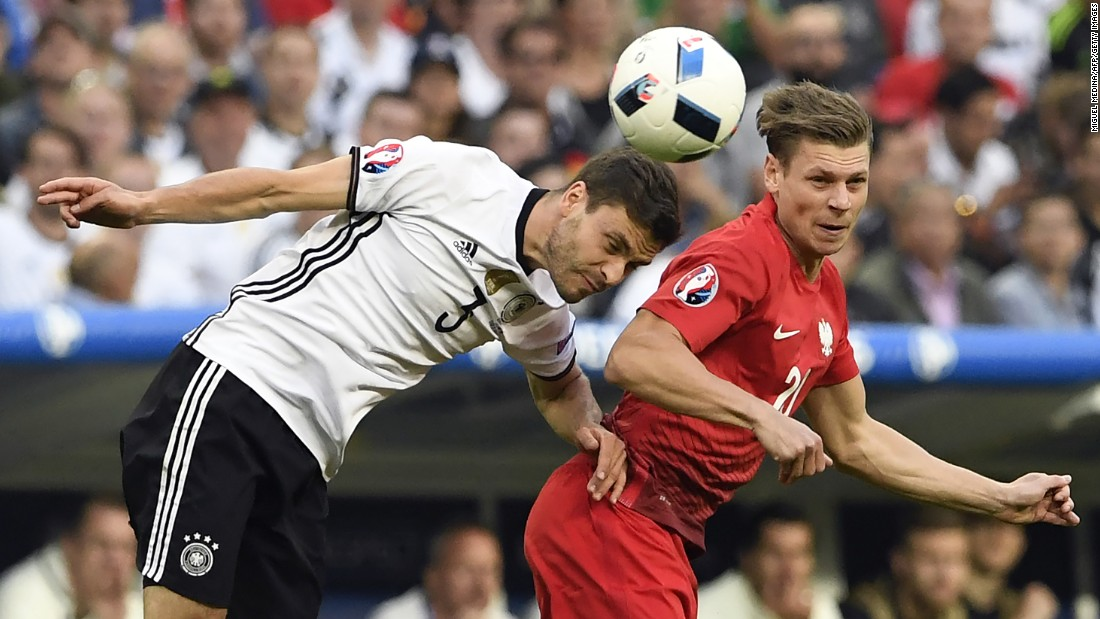 German defender Jonas Hector heads the ball near Poland's Lukasz Piszczek during a goalless draw at Euro 2016.
