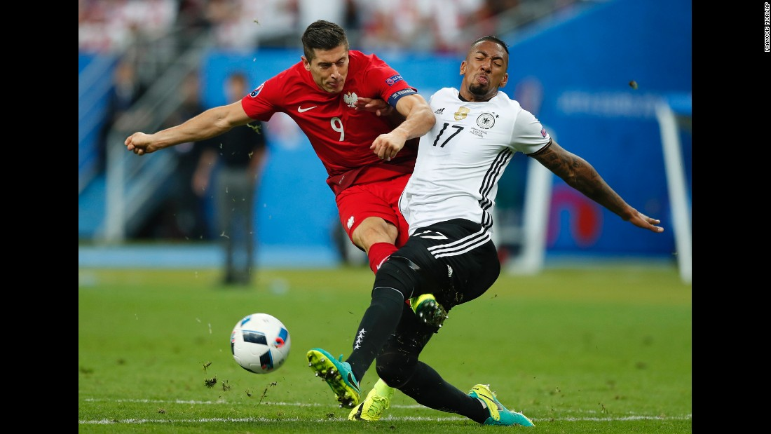 Lewandowski collides with German defender Jerome Boateng.