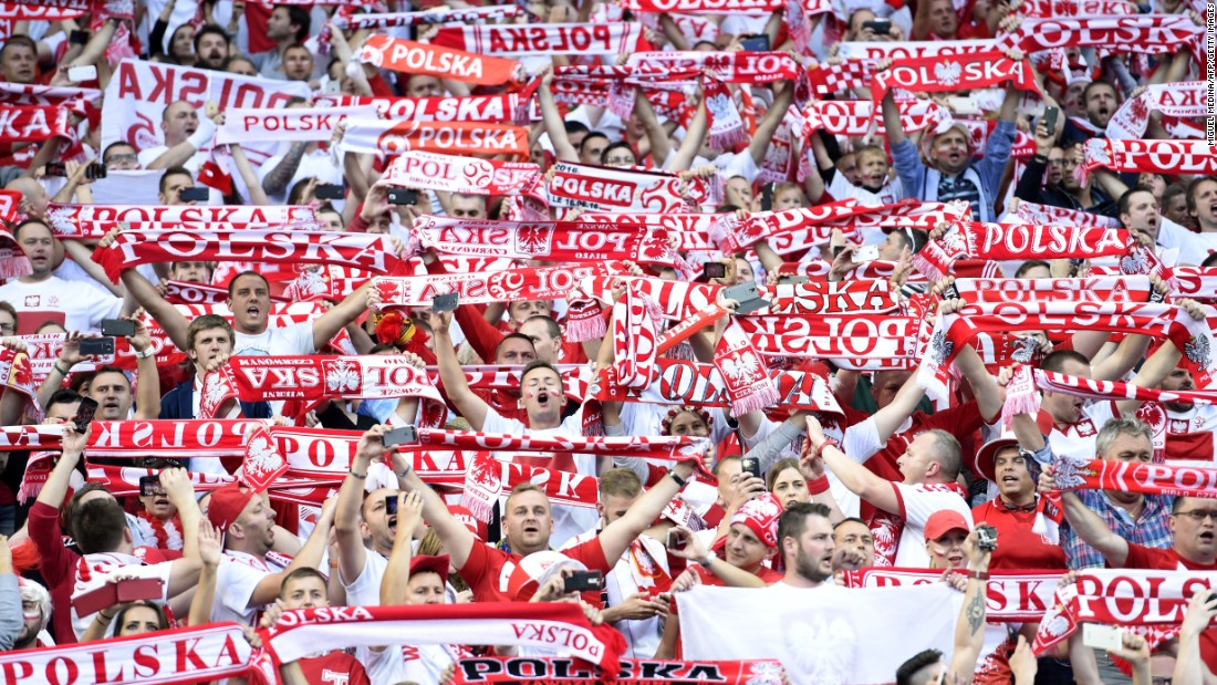 Poland supporters wave scarves at the Stade de France north of Paris.