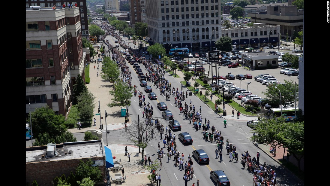 "People line a street in Louisville, Kentucky, as <a href=""http://www.cnn.com/2016/06/10/us/gallery/muhammad-ali-funeral/index.html"" target=""_blank"">Muhammad Ali's funeral procession</a> passes by on Friday, June 10. The boxing legend died June 3 at the age of 74."