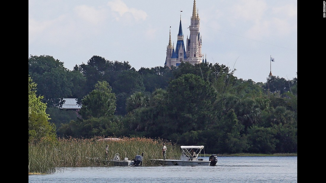 "With Disney World's Magic Kingdom in the distance, authorities search for the body of a toddler <a href=""http://www.cnn.com/2016/06/16/us/alligator-attacks-child-disney-florida/"" target=""_blank"">who was dragged underwater by an alligator</a> in Lake Buena Vista, Florida. Lane Graves, 2, was found dead on Wednesday, June 15, a day after the alligator got him as he waded in a lagoon at the Grand Floridian resort."
