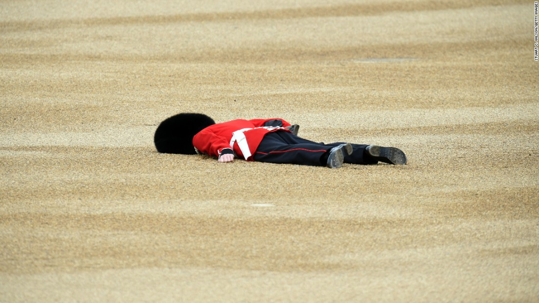 A member of the Queen's Guard fainted during the Trooping the Color parade in London on Saturday, June 11. He recovered and returned to duty, authorities said.