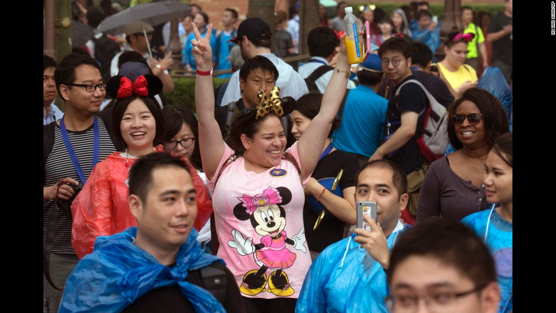 "Visitors enjoy the opening day of <a href=""http://www.cnn.com/2016/06/15/travel/inside-shanghai-disneyland/"" target=""_blank"">the new Disney Resort</a> in Shanghai, China, on Thursday, June 16. According to Disney officials, it's the brand's biggest international park."