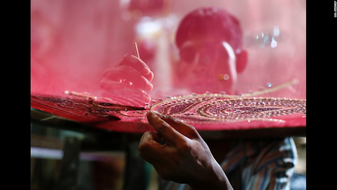 A man embroiders a dress in Dhaka, Bangladesh, on Tuesday, June 16. The dress will be sold ahead of Eid al-Fitr, the Muslim holiday marking the end of Ramadan.